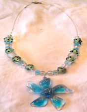 Blue flower necklace with blue and green beads